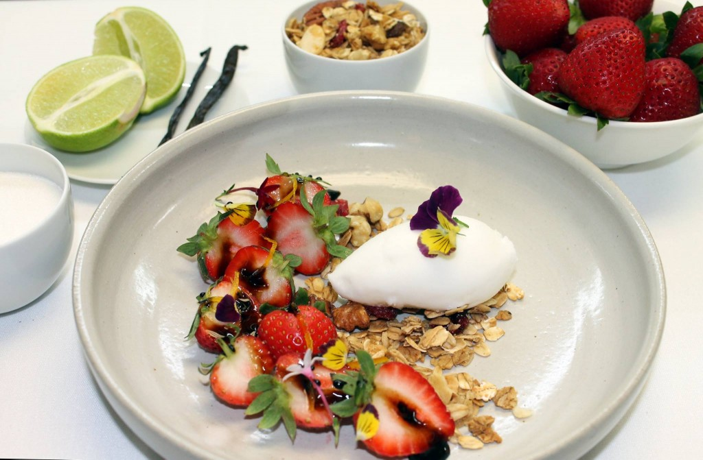 toss local strawberries with balsamic vinegar a pinch of sugar granola and a scoop of lime sorbet