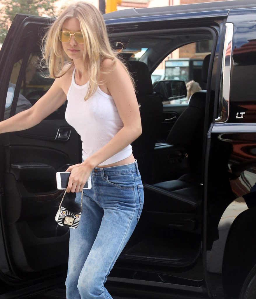 , New York, NY - 06/26/2017 - Gigi Hadid keeps it simple and sexy in a white tank top and jeans -PICTURED: Gigi Hadid -PHOTO by: DARA KUSHNER/INSTARimages.com -Instar_Gigi_Hadid_White_Tank_Top_10011206403 Editorial Rights Managed Image - Please contact www.INSTARimages.com for licensing fee and rights: North America Inquiries: email sales@instarimages.com or call 212.414.0207 - UK Inquiries: email ben@instarimages.com or call + 7715 698 715 - Australia Inquiries: email sarah@instarimages.com.au  or call +02 9660 0500 – for any other Country, please email sales@instarimages.com.  Image or video may not be published in any way that is or might be deemed defamatory, libelous, pornographic, or obscene / Please consult our sales department for any clarification or question you may have - http://www.INSTARimages.com reserves the right to pursue unauthorized users of this image or video. If you are in violation of our intellectual property you may be liable for actual damages, loss of income, and profits you derive from the use of this image or video, and where appropriate, the cost of collection and/or statutory damage.